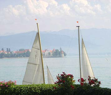 LindauView: View over Lake Constance with sailboats and cumulus clouds