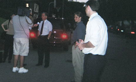 BigDeanArrives: Howard Dean talks to TV cameras en route to NH house party.