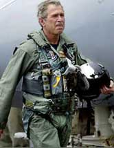 "Bush in flight suit: ""Karl Rove told me to stick a sock in it."""