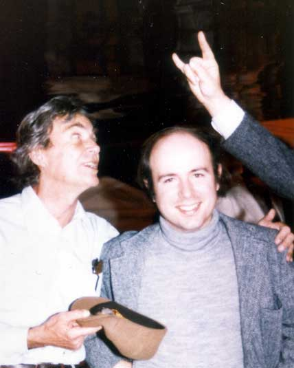"FeynmanWilczek: Richard Feynman with Frank Wilczek, at Murph Goldberger's 60th birthday party, 1983, ""devil horns"" by Sam Treiman."