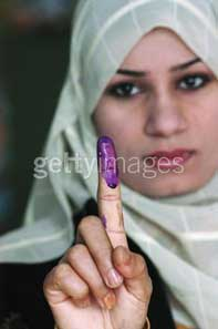 IraqVoter: Iraq woman voter shows inked finger, January 2005