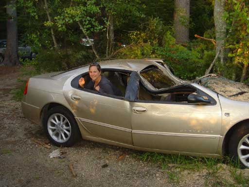 MickeyCar: Amity Wilczek in Frank Wilczek's smooshed car, August, 2006