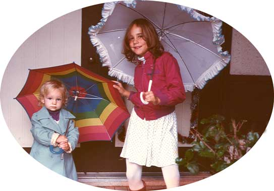 Mira and Amity with umbrellas, December 1984