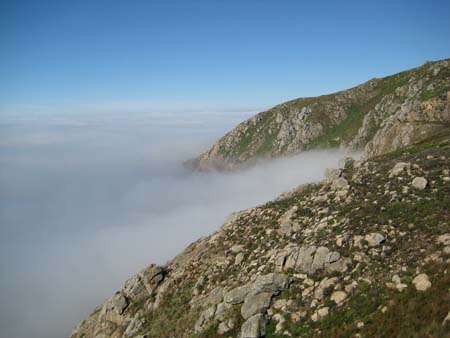 Fisterra coast emerges from fog