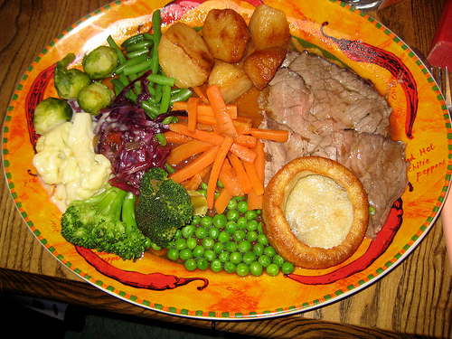 roast beef with Yorkshire pudding and veggies, traditional Sunday dinner in England